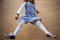 pantyhose kid - Girl Jumping Mid Air in front of Wall, Cropped Stock Photo - Premium Rights-Managednull, Code: 822-05554997