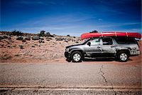 Parked Car with Red Canoe on Roof Stock Photo - Premium Rights-Managednull, Code: 822-05555012