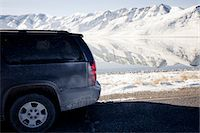Car Parked on Road with Lake and Snow Covered Mountains Stock Photo - Premium Rights-Managednull, Code: 822-05555039