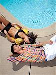 Couple Sunbathing on the Edge of Swimming Pool, High Angle View Stock Photo - Premium Rights-Managed, Artist: ableimages, Code: 822-05555105