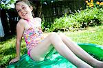 Girl Leaning on the Edge of Paddling Pool