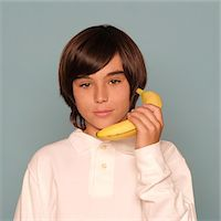 Boy Holding Banana as if Telephone Stock Photo - Premium Rights-Managednull, Code: 822-05555197