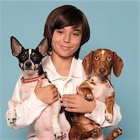 Boy Holding Two Dogs in his Arms Stock Photo - Premium Rights-Managednull, Code: 822-05555199
