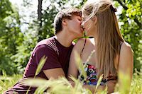 Teenage couple kissing in tall grass Stock Photo - Premium Royalty-Freenull, Code: 649-05555597