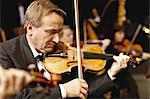 Violin player in orchestra Stock Photo - Premium Royalty-Free, Artist: R. Ian Lloyd, Code: 649-05555726