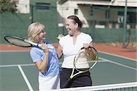 Older women hugging on tennis court Stock Photo - Premium Royalty-Freenull, Code: 649-05555774