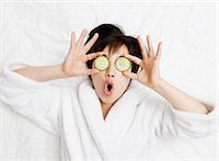 facial - Woman in bathrobe with cucumbers on eyes Stock Photo - Premium Royalty-Freenull, Code: 649-05555826