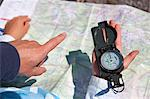 Father and son using compass and map Stock Photo - Premium Royalty-Free, Artist: AWL Images, Code: 649-05556045