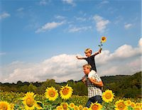 riding crop - Father and son in field of flowers Stock Photo - Premium Royalty-Freenull, Code: 649-05556050
