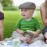 Boy eating rice cake at picnic Stock Photo - Premium Royalty-Free, Artist: Cultura RM, Code: 649-05556147