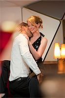 Smiling couple dancing in bar Stock Photo - Premium Royalty-Freenull, Code: 649-05556309