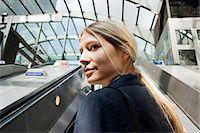 Businesswoman on subway escalators Stock Photo - Premium Royalty-Freenull, Code: 614-05556693