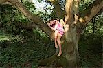 Young woman draped in an old oak tree Stock Photo - Premium Royalty-Free, Artist: CulturaRM, Code: 614-05557121