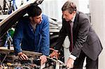 Businessman looking at car engine with mechanic Stock Photo - Premium Royalty-Free, Artist: CulturaRM, Code: 614-05557269