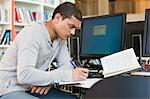 University student working at computer desk Stock Photo - Premium Royalty-Free, Artist: Andrew Kolb, Code: 614-05557286