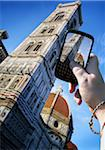Woman's Hand Taking Photo of Basilica di Santa Maria del Fiore, Florence, Italy Stock Photo - Premium Royalty-Free, Artist: Andrew Kolb, Code: 600-05560148