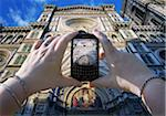 Woman's Hands Taking Photo of Basilica di Santa Maria del Fiore, Florence, Italy Stock Photo - Premium Royalty-Free, Artist: Andrew Kolb, Code: 600-05560149