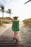 Little Girl Walking on Beach Boardwalk Stock Photo - Premium Rights-Managednull, Code: 700-05560266
