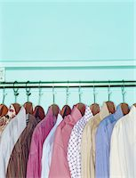 Button down shirts on hangers on clothes rack Stock Photo - Premium Royalty-Freenull, Code: 6106-05562089