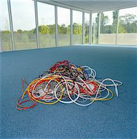 phone cord - Pile of assorted computer cables on floor in empty room Stock Photo - Premium Royalty-Freenull, Code: 6106-05562121
