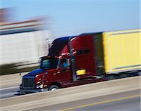 side view tractor trailer truck - Semi-truck on highway, side view (blurred motion) Stock Photo - Premium Royalty-Freenull, Code: 6106-05563320