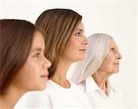 Mother, daughter (11-13)  and grandmother, smiling, profile Stock Photo - Premium Royalty-Freenull, Code: 6106-05563453