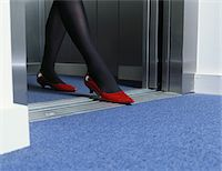 stocking feet - Young woman exiting lift, low section Stock Photo - Premium Royalty-Freenull, Code: 6106-05563908