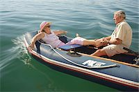 side view of person rowing in boat - Senior couple in small boat, man massaging woman's feet Stock Photo - Premium Royalty-Freenull, Code: 6106-05565225