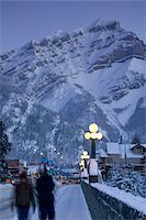 small town snow - Canada, Alberta, Banff, Mt. Norquay and street scene at dawn, winter Stock Photo - Premium Royalty-Freenull, Code: 6106-05565688