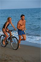 Father and daughter on beach Stock Photo - Premium Royalty-Freenull, Code: 6106-05569279