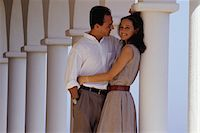 Couple embracing against columns Stock Photo - Premium Royalty-Freenull, Code: 6106-05571557