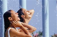 shower - Two young women taking shower outdoors Stock Photo - Premium Royalty-Freenull, Code: 6106-05572494