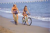Young couple cycling along beach Stock Photo - Premium Royalty-Freenull, Code: 6106-05572523