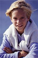 Boy (8-9) smiling, outdoors, arms folded, portrait Stock Photo - Premium Royalty-Freenull, Code: 6106-05572653