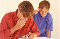 Father smoking cigarettes, son (10-11) standing next to man Stock Photo - Premium Royalty-Freenull, Code: 6106-05573084