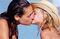 preteen kissing - Mother kissing daughter (10-11), side view Stock Photo - Premium Royalty-Freenull, Code: 6106-05575748