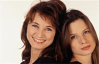 represented - Mother and daughter head to head, portrait Stock Photo - Premium Royalty-Freenull, Code: 6106-05576667
