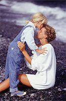 Daughter (4-5) kissing mother on forehead, side view Stock Photo - Premium Royalty-Freenull, Code: 6106-05576743