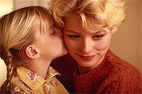 Girl kissing mother on cheek Stock Photo - Premium Royalty-Freenull, Code: 6106-05578109