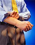 Man rolling up sleeves, mid section, (Close-up) Stock Photo - Premium Royalty-Free, Artist: I Dream Stock, Code: 6106-05580480
