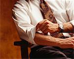 Man rolling up sleeves, (Close-up) Stock Photo - Premium Royalty-Freenull, Code: 6106-05580878