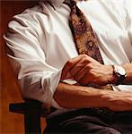 Man rolling up sleeves, (Close-up) Stock Photo - Premium Royalty-Freenull, Code: 6106-05580884
