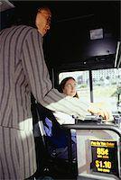 Woman entering bus, paying fare Stock Photo - Premium Royalty-Freenull, Code: 6106-05581006