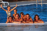 preteen girls stretching - Group of people pool's edge Stock Photo - Premium Royalty-Freenull, Code: 6106-05582286