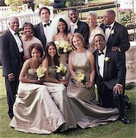 Bride and groom with wedding party, smiling, portrait Stock Photo - Premium Royalty-Freenull, Code: 6106-05583738