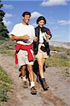 Young couple hiking in mountains Stock Photo - Premium Royalty-Freenull, Code: 6106-05583904