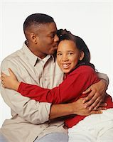preteen kissing - Father kissing daughter (12-13) on forehead, posing in studio, portrait Stock Photo - Premium Royalty-Freenull, Code: 6106-05584224