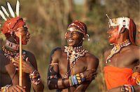 Three young Samburu warriors in costume, conversing, close-up Stock Photo - Premium Royalty-Freenull, Code: 6106-05585052