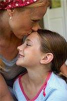 preteen kissing - Mother kissing daughter (10-12) on forehead Stock Photo - Premium Royalty-Freenull, Code: 6106-05586340