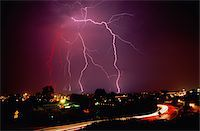 Lightning storm over cityscape Stock Photo - Premium Royalty-Freenull, Code: 6106-05586733